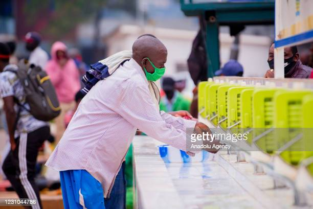Rwandan people wearing face masks are seen outside after 3 weeks curfew implemented to stem the spread of the coronavirus pandemic was ended in...