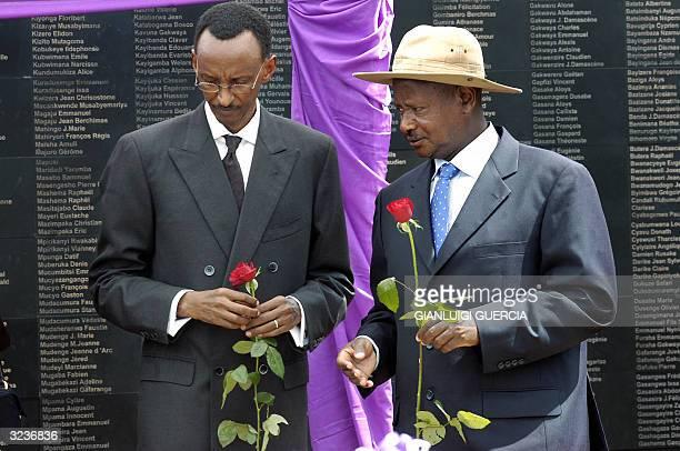 Rwandan President Paul Kagame and Ugandan President Yoweri Museveni hold roses 07 April 2004 before laying them on the graves at the Memorial...