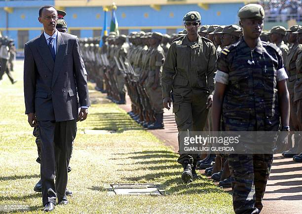 Rwandan President Paul Kagame inspects 04 July 2004 the military parade in Kigali which will mark the 10th anniversary of power held by the Rwandan...