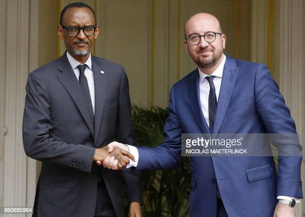 Rwandan President Paul Kagame shakes hands with Belgian Prime Minister Charles Michel prior to a meeting in Brussels on June 8 2017 / AFP PHOTO /...