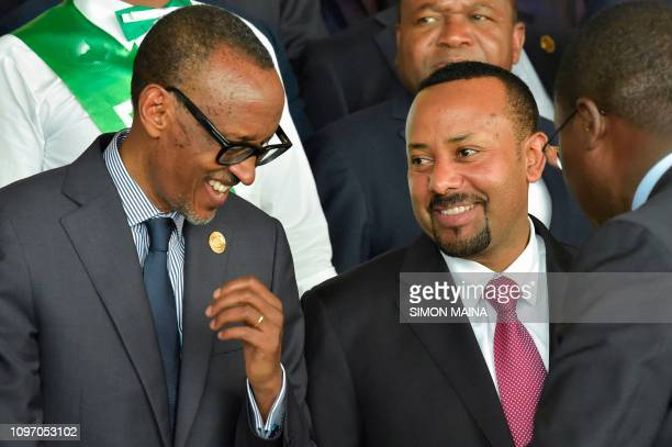 Rwandan President Paul Kagame talks with Ethiopian Prime Minister Abiy Ahmed during the 32nd African Union summit in Addis Ababa on February 10 2019...