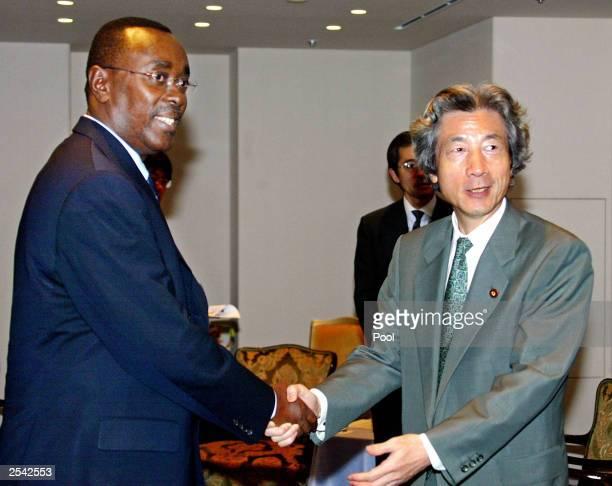 Rwandan Prime Minister Bernard Makuza shakes hands with Japanese Prime Minister Junichiro Koizumi at a hotel September 28 2003 in Tokyo Japan Makuza...