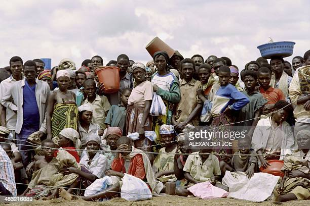 Rwandan refugees wait for food at the refugee camp of Benako on May 21 1994 after fleeing the massacres that has claimed an estimated 500000 people...