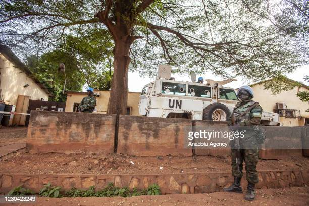 Rwandan security officials serving in the United Nations Peacekeeping Forces take measures around the site near National Elections Authority building...