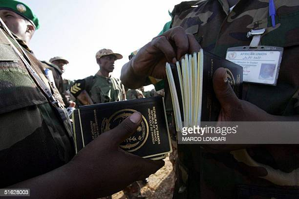 Rwandan troops of the African Union Cease Fire Commission have 30 October 2004 their passports checked by Africa Union officials upon their arrival...