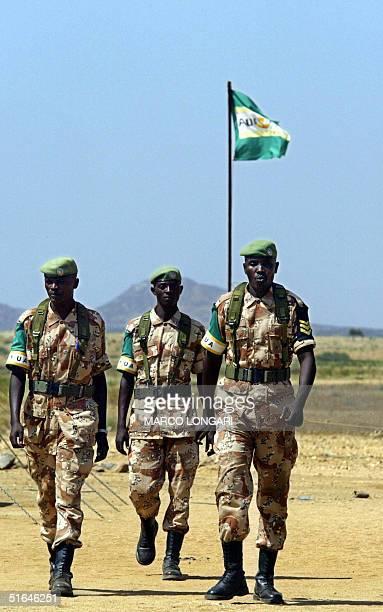 Rwandan troops operating under the Africa Union mandate walk 02 November 2004 inside the AU base in Kab Kabiya north west of ElFasher Sudan 196...