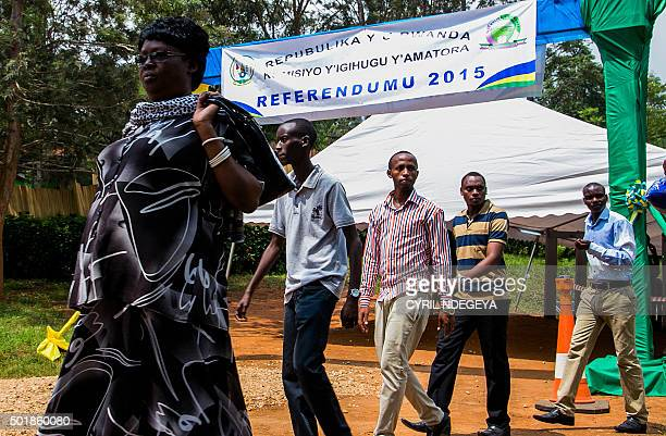 Rwandan voters leave after casting their ballots at a polling station in Kigali on December 18 2015 in a referendum to amend the constitution...