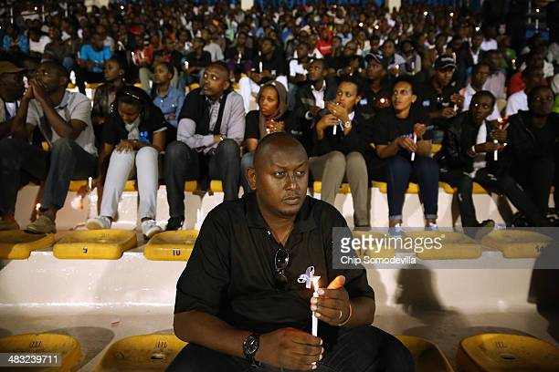 Rwandans hold a candle light vigil at Amahoro Stadium during the 20th anniversary commemoration of the 1994 genocide April 7, 2014 in Kigali, Rwanda....