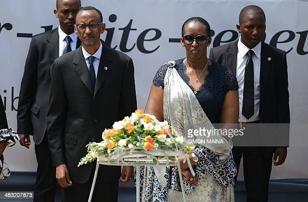 Rwanda's president Paul Kagame and First Lady Janet Kagame lay a wreath of flower at the the Gizosi Genocide Memorial in Kigalia on April 72014...