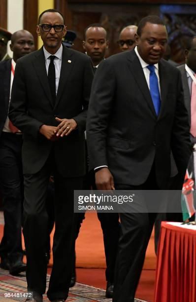 Rwanda's President Paul Kagame arrives with his Kenyan counterpart President Uhuru Kenyatta at the 14th Summit of the Northern Corridor Integration...