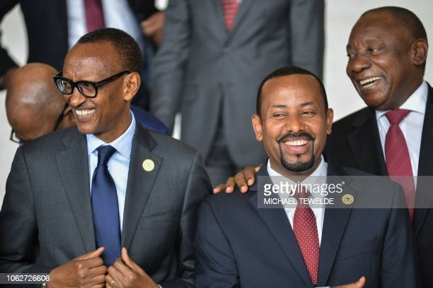 Rwanda's President Paul Kagame Ethiopia Prime Minister Abiy Ahmed and South African President Cyril Ramaphosa pose for a family photo on November 17...