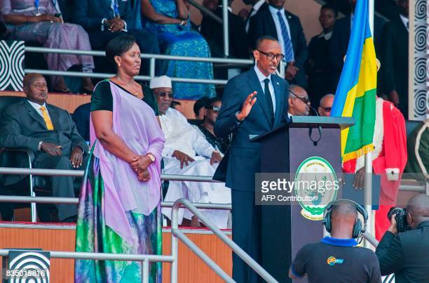 Rwanda's President Paul Kagame flanked by his wife Jeannette Kagame speaks after being sworn in as Rwanda's Head of State for next the 7 years on...