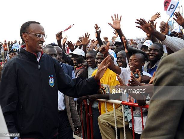 Rwanda's President Paul Kagame greets supporters at the launch of his reelection campaign on July 20 2010 at a rally in the capital Kigali Kagame...