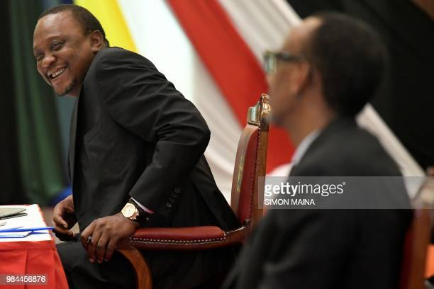 Rwanda's President Paul Kagame looks towards Kenya's President Uhuru Kenyatta during the 14th Summit of the Northern Corridor Integration Projects in...