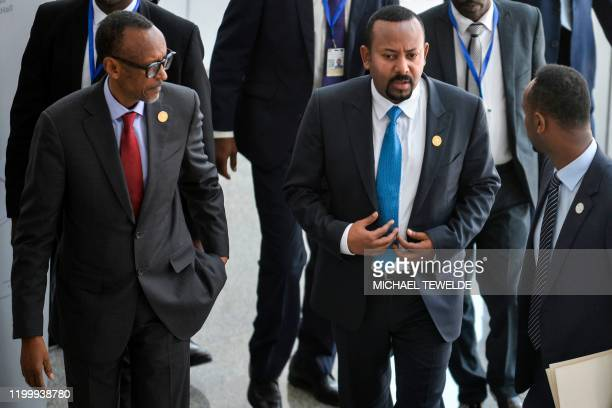 Rwanda's President, Paul Kagame walks alongside his host, Ethiopia's Prime Minister, Abiy Ahmed at the African Union headquarters in Addis Ababa, on...