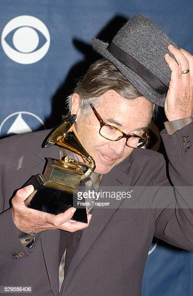 Ry Cooder doffs his hat in the press room with his award for Best Pop Instrumental Album at the 46th annual Grammy Awards