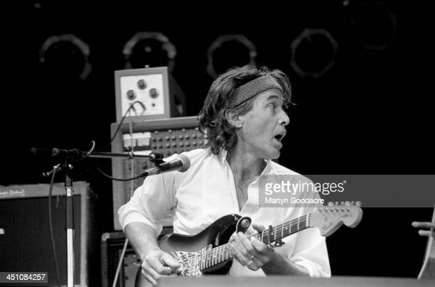 Ry Cooder performs on stage at Glastonbury Festival United Kingdom 1990