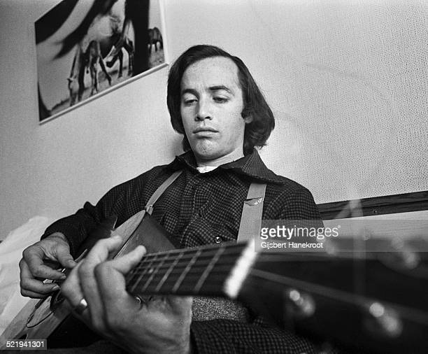 Ry Cooder plays his guitar during an interview Amsterdam Netherlands in 1973