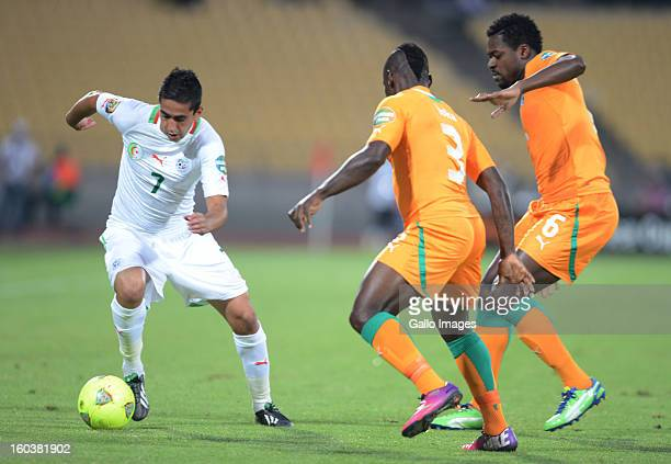 Ryad Boudebouz of Algeria competes with Arthur Etienne Boka and Romaric N'Dri of Ivory Coast during the 2013 African Cup of Nations match between...