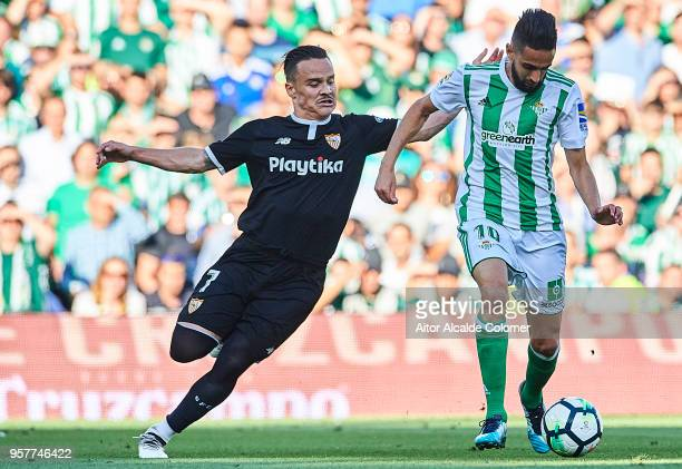 Ryad Boudebouz of Real Betis Balompie being followed by Roque Mesa of Sevilla FC during the La Liga match between Real Betis and Sevilla at Estadio...