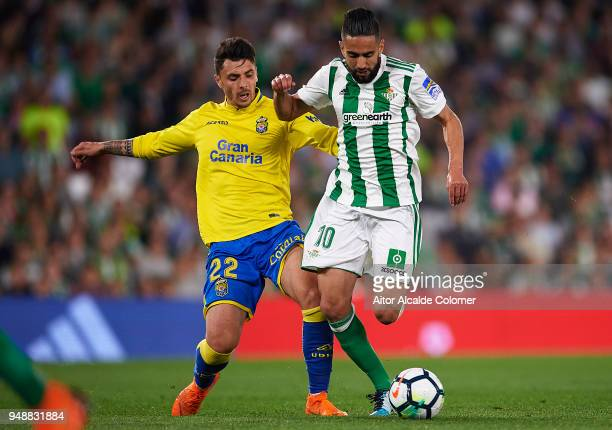 Ryad Boudebouz of Real Betis Balompie being followed by Ximo Navarro of Union Deportiva Las Palmas during the La Liga match between Real Betis and...