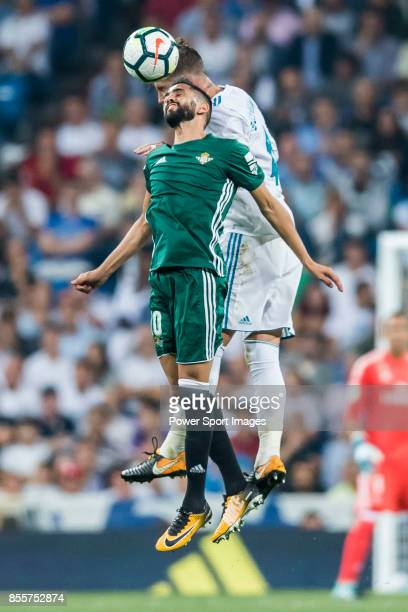 Ryad Boudebouz of Real Betis fights for the ball with Sergio Ramos of Real Madrid during the La Liga 201718 match between Real Madrid and Real Betis...