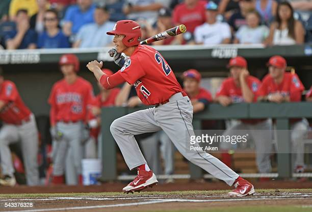 Ryan Aguilar of the Arizona Wildcats hits an RBI single against the Coastal Carolina Chanticleers in the first inning during game one of the College...