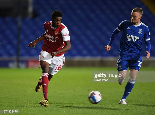 Ryan Alebiosu of Arsenal takes on Freddie Sears of Ipswich during the Leasingcom Cup match between Ipswich Town and Arsenal U21 at Portman Road on...