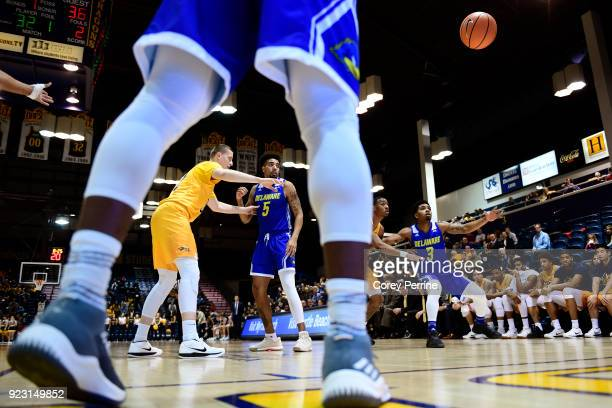 Ryan Allen inbound passes to Anthony Mosley of the Delaware Fightin Blue Hens during the first half at the Daskalakis Athletic Center on February 22...