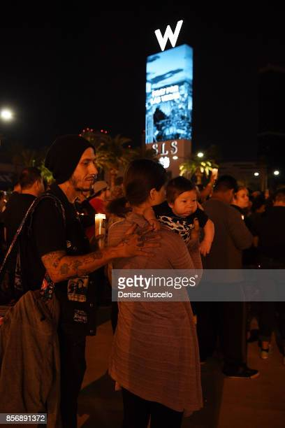 Ryan Allen, Katie Allen and Destry Allen attend a vigil on the Las Vegas strip, for the victims of the Route 91 Harvest country music festival...