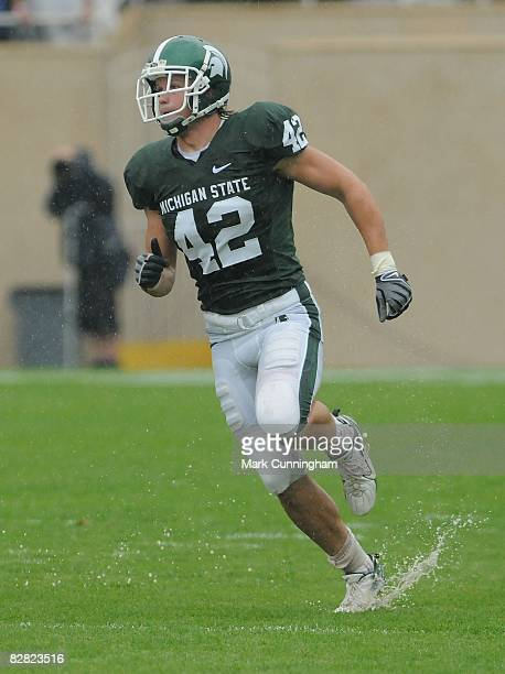 Ryan Allison of the Michigan State Spartans runs down field in the rain against the Florida Atlantic University Owls on September 13, 2008 at Spartan...