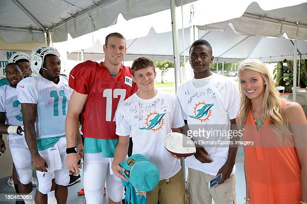 Ryan and Lauren Tannehill host students from American Senior High School at Dolphins training camp on August 15 2013 in Davie Florida