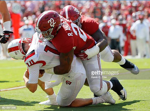 Ryan Anderson and Jonathan Allen of the Alabama Crimson Tide sack Mike White of the Western Kentucky Hilltoppers at BryantDenny Stadium on September...