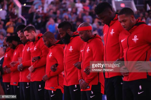 Ryan Anderson Chris Paul James Harden and Eric Gordon of the Houston Rockets link arms for the national anthem before the NBA game against the...