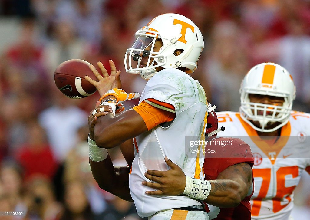Ryan Anderson #22 of the Alabama Crimson Tide forces a turnover as he tackes Joshua Dobbs #11 of the Tennessee Volunteers in the final seconds of their 19-14 win at Bryant-Denny Stadium on October 24, 2015 in Tuscaloosa, Alabama.