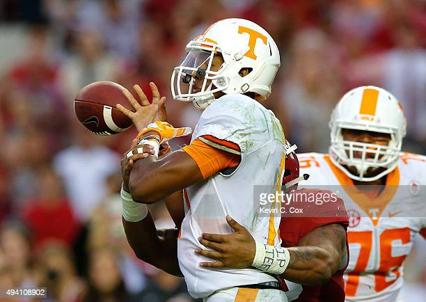 Ryan Anderson of the Alabama Crimson Tide forces a turnover as he tackes Joshua Dobbs of the Tennessee Volunteers in the final seconds of their 1914...