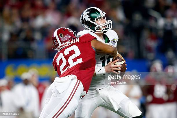 Ryan Anderson of the Alabama Crimson Tide sacks Connor Cook of the Michigan State Spartans in the second quarter during the Goodyear Cotton Bowl at...