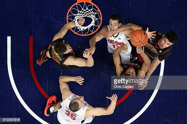 Ryan Anderson of the Arizona Wildcats battles for a rebound with Elijah Stewart and Bennie Boatwright of the USC Trojans during the second half of...
