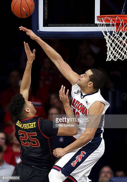 Ryan Anderson of the Arizona Wildcats blocks a shot by Bennie Boatwright of the USC Trojans during the first half of the college basketball game at...