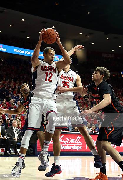 Ryan Anderson of the Arizona Wildcats grabs a rebound during the first half of the college basketball game against the Pacific Tigers at McKale...