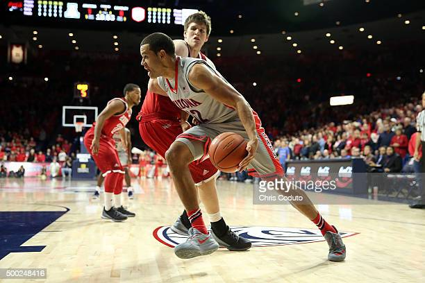 Ryan Anderson of the Arizona Wildcats is defended by Luuk van Bree of the Bradley Braves during the first half of the college basketball game at...