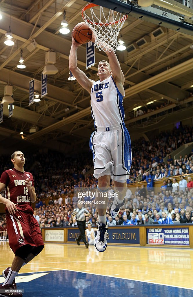Ryan Anderson #12 of the Boston College Eagles watches as Mason Plumlee #5 of the Duke Blue Devils dunks the ball during their game at Cameron Indoor Stadium on February 24, 2013 in Durham, North Carolina.