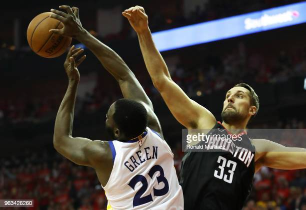 Ryan Anderson of the Houston Rockets and Draymond Green of the Golden State Warriors vie for a rebound in the second quarter of Game Seven of the...