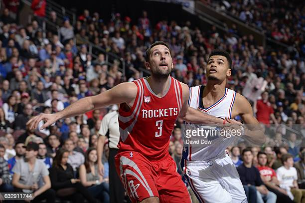 Ryan Anderson of the Houston Rockets boxes out Richaun Holmes of the Philadelphia 76ers at Wells Fargo Center on January 27 2017 in Philadelphia...