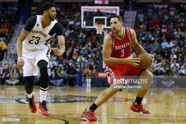 Ryan Anderson of the Houston Rockets drives against Anthony Davis of the New Orleans Pelicans during the second half of a game at Smoothie King...