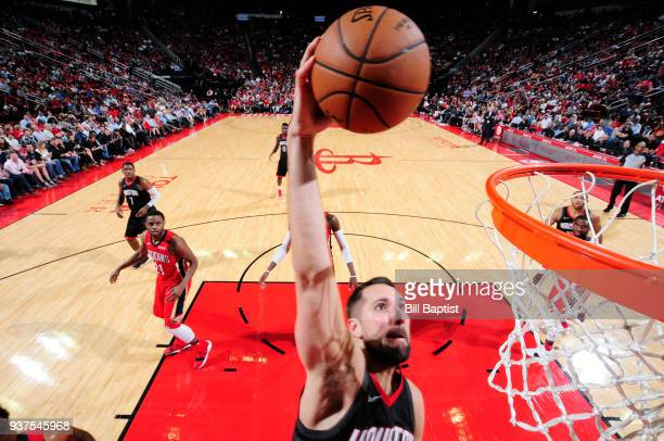 Ryan Anderson of the Houston Rockets goes up for a dunk against the New Orleans Pelicans on March 24 2018 at the Toyota Center in Houston Texas NOTE...