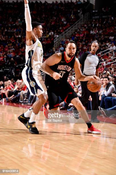 Ryan Anderson of the Houston Rockets handles the ball against Gary Harris of the Denver Nuggets during the game between the two teams on February 9...