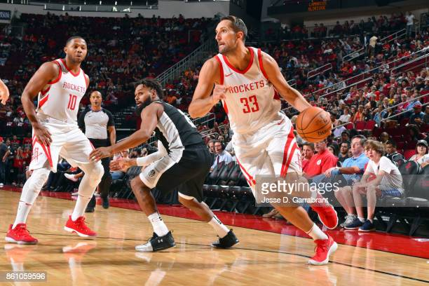 Ryan Anderson of the Houston Rockets handles the ball during the preseason game against the San Antonio Spurs on October 13 2017 at Toyota Center in...