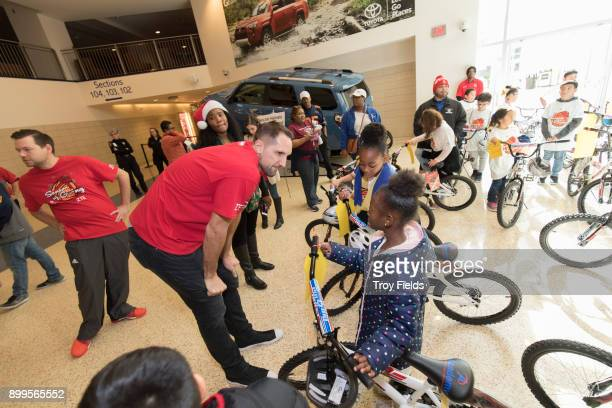 Ryan Anderson of the Houston Rockets participates in the 2017 Season of Giving presented by ZTE with a holiday party and a surprise bike giveaway on...