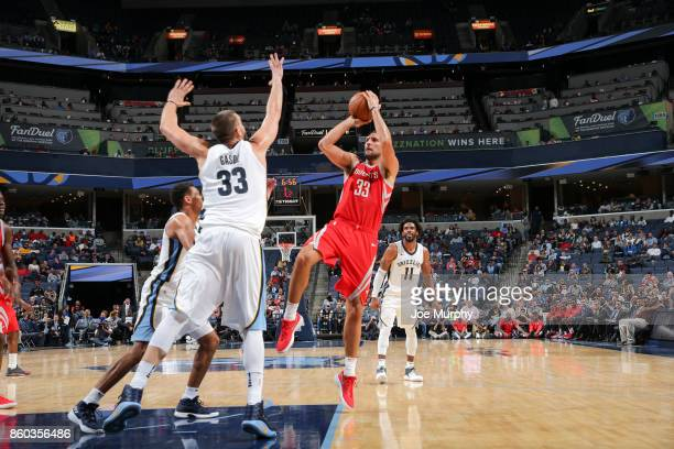 Ryan Anderson of the Houston Rockets shoots the ball against Marc Gasol of the Memphis Grizzlies during a preseason game on October 11 2017 at...